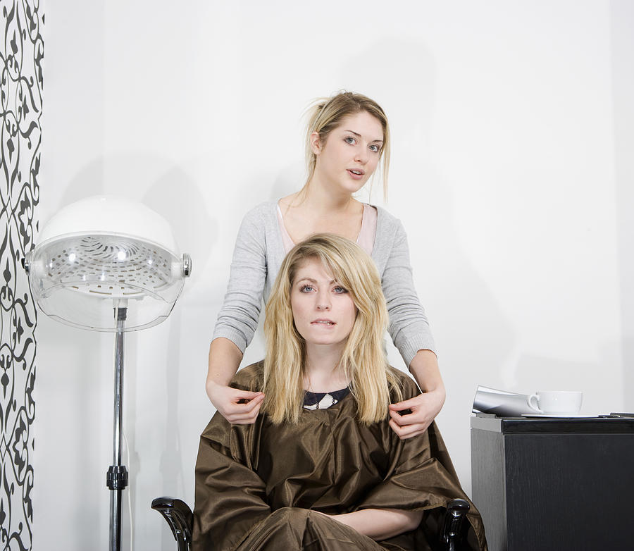 Woman at hairdresser Photograph by Bill Sykes