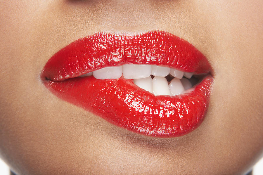 Woman Biting Lip Photograph by Moodboard