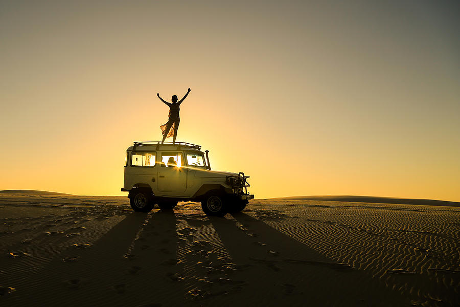 Woman Celebrating On Top Of Offroad Car Photograph by Brunomsbarreto