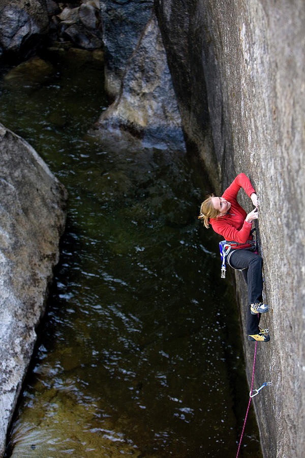 Action Photograph - Woman Climbing Above A River by Corey Rich
