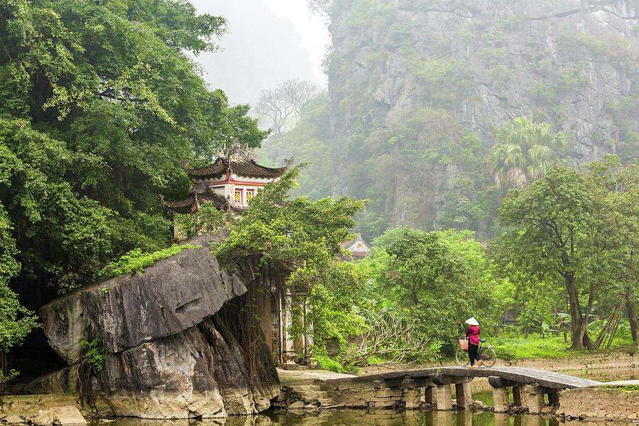 Woman Crossing Bridge To Temple, Ninh Photograph by Peter Adams