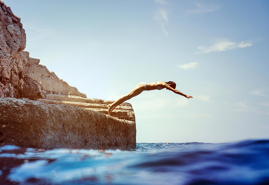 Woman Diving In The Sea Photograph by Hans Neleman