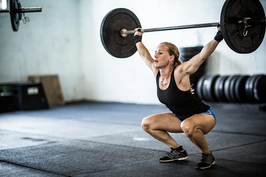 Woman Doing Gym Snatch Photograph by Momo Productions