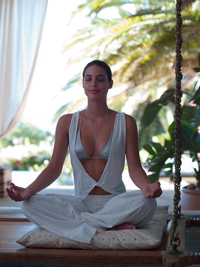Woman doing yoga Photograph by Chris Ryan