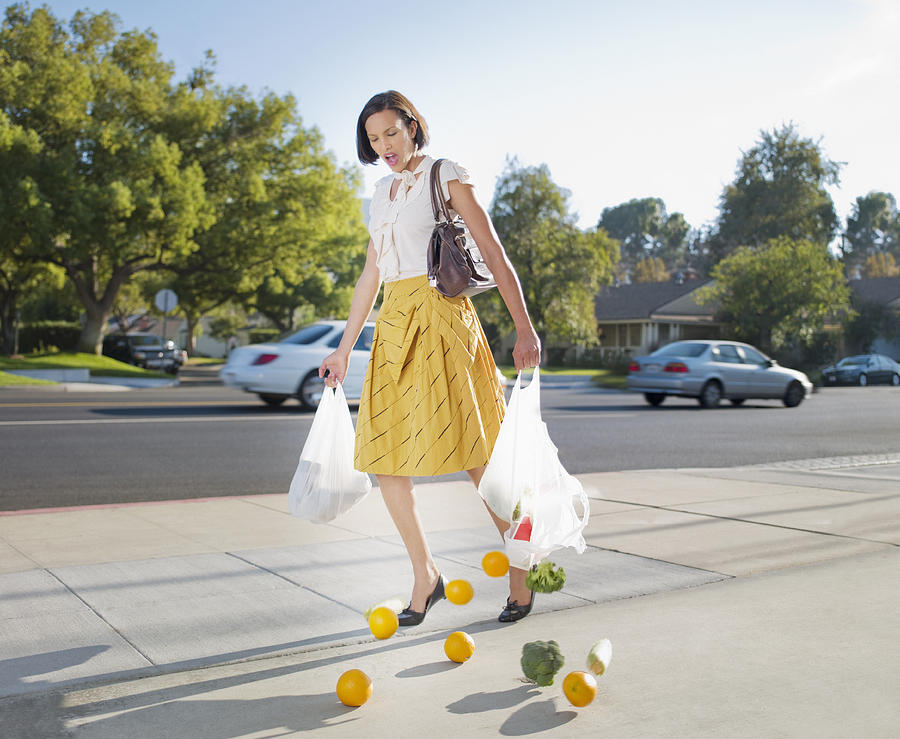 Woman Dropping Groceries On Sidewalk Photograph by Chris Ryan
