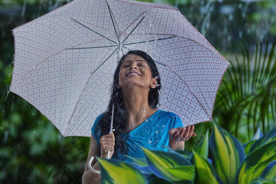 Woman enjoying in the rain Photograph by Abhinandita Mathur