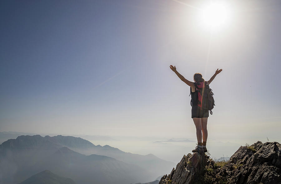 Woman Exulting On A Mountaintop Photograph by Buena Vista Images