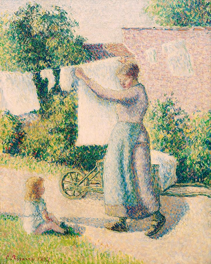 Art Painting - Woman Hanging Laundry by Camille Pissarro
