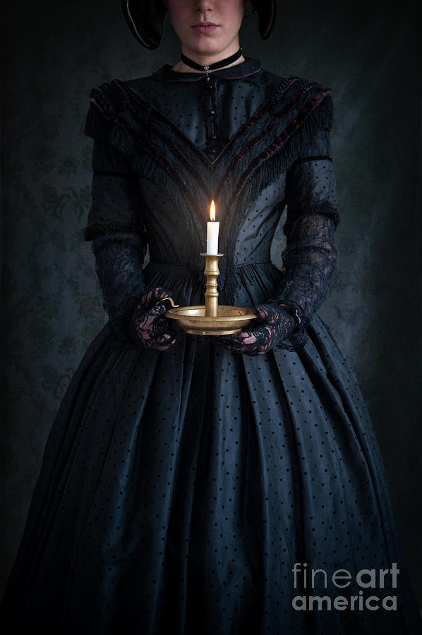 Woman In A Victorian Mourning Dress Holding A Candle
