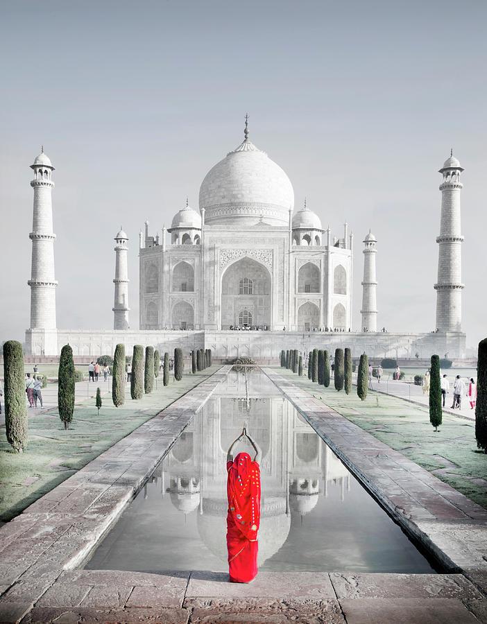 Woman In Red Sari Praying At Taj Mahal Photograph by Grant Faint