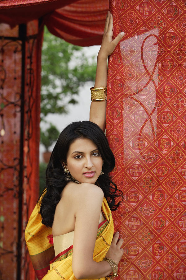 Woman In Yellow Sari, Red Tent Photograph by Alex Mares-Manton