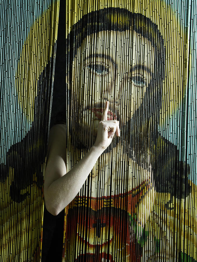 Woman indicating quiet through beaded curtain with image of Jesus Photograph by Hans Neleman