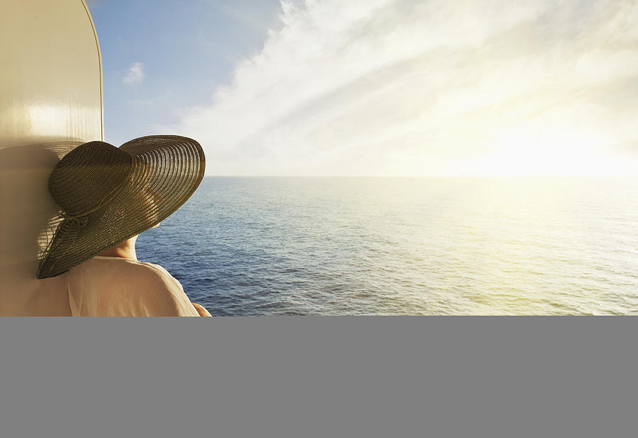 Woman looking out to sea on a cruise ship Photograph by Buena Vista Images