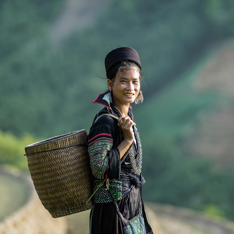Woman Of Black Hmong Hill Tribe Next To Photograph by Martin Puddy