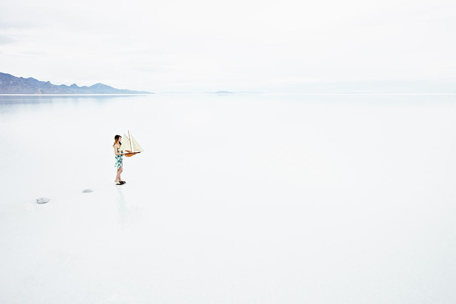 Woman On Path In Lake Holding Model Photograph by Thomas Barwick