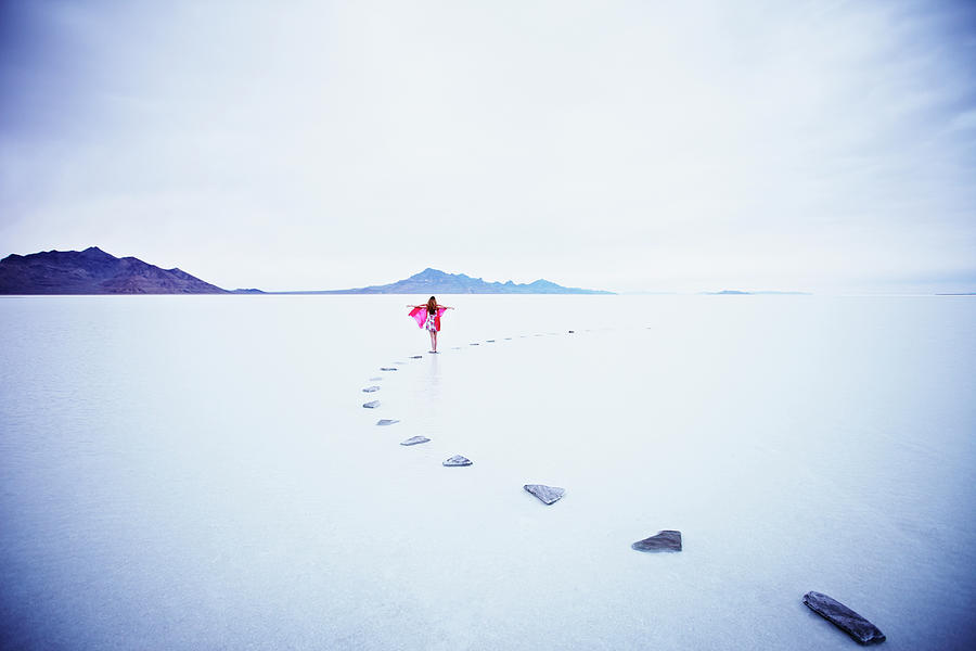 Woman On Stone Pathway In Lake With Photograph by Thomas Barwick