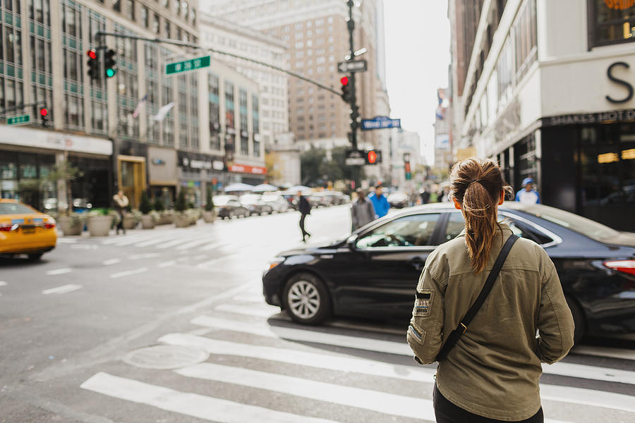 Woman on street Photograph by Johner Images