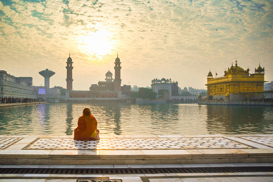 Woman pray at Golden temple Photograph by Rajdeep Ghosh