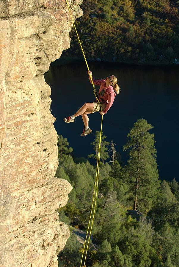 woman-rappelling-off-sandstone-cliff-ken
