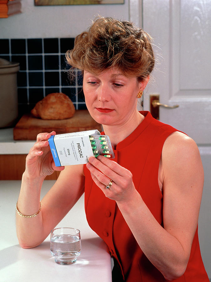 Prozac Drug Photograph - Woman Reading Dose Label On Pack Of Prozac Pills by Damien Lovegrove/science Photo Library