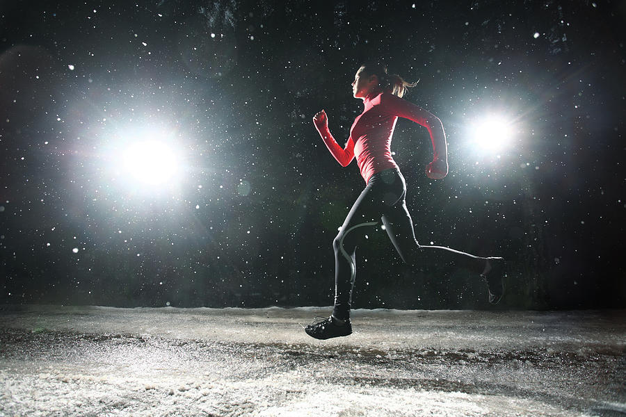 Woman Running At Night In Snow Photograph by Stanislaw Pytel