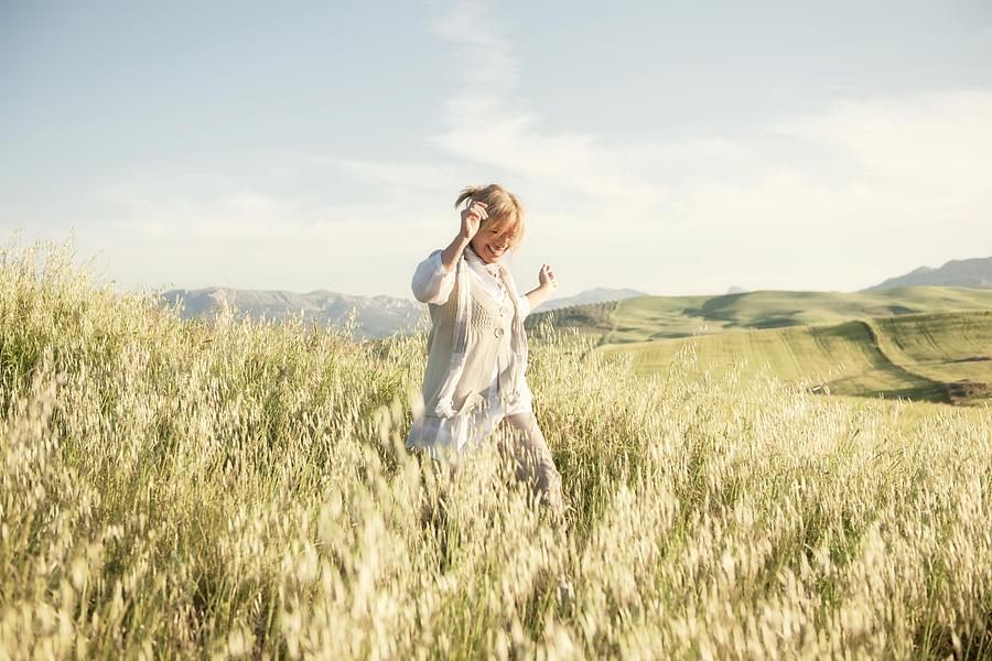 Woman running in grassy field Photograph by WillSelarep