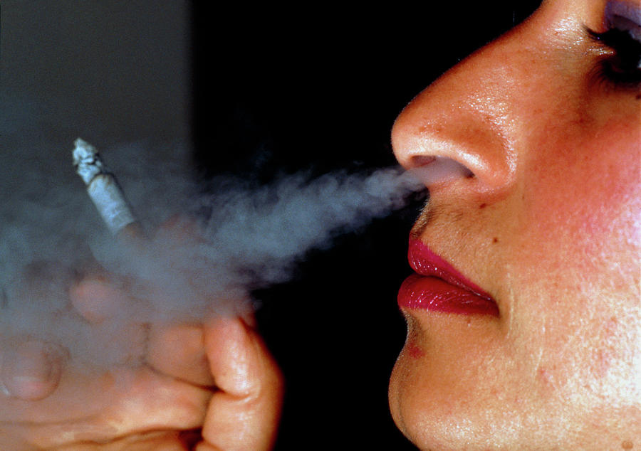 Smoking Photograph - Woman Smoking A Cigarette by Harvey Pincis/science Photo Library