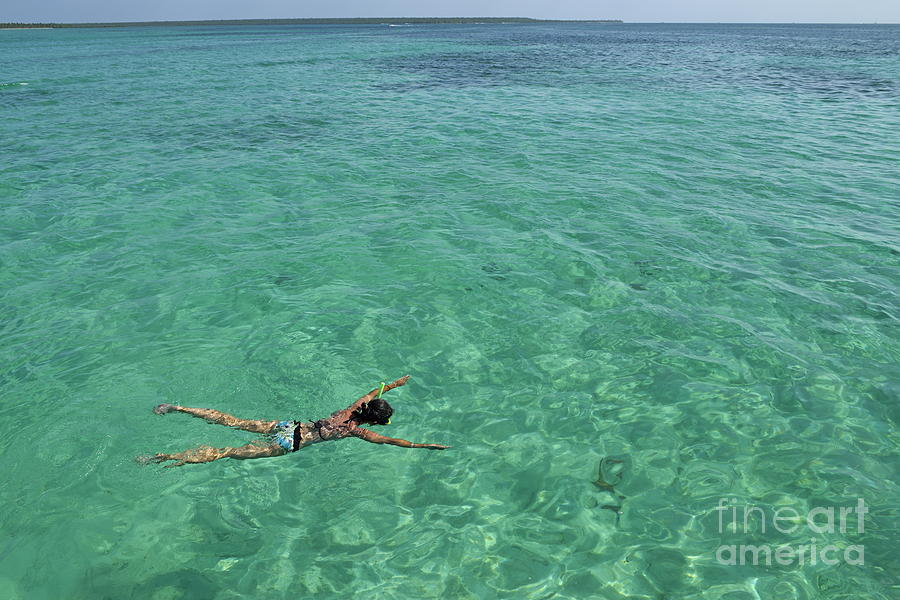People Photograph - Woman Snorkeling By Turquoise Sea by Sami Sarkis
