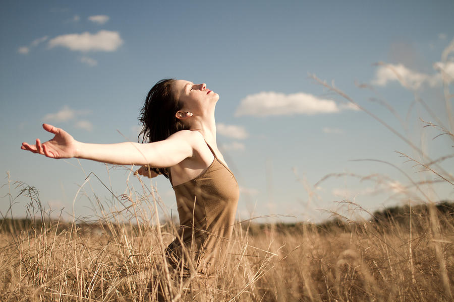 Woman standing in long grass Photograph by LiFE on Manual