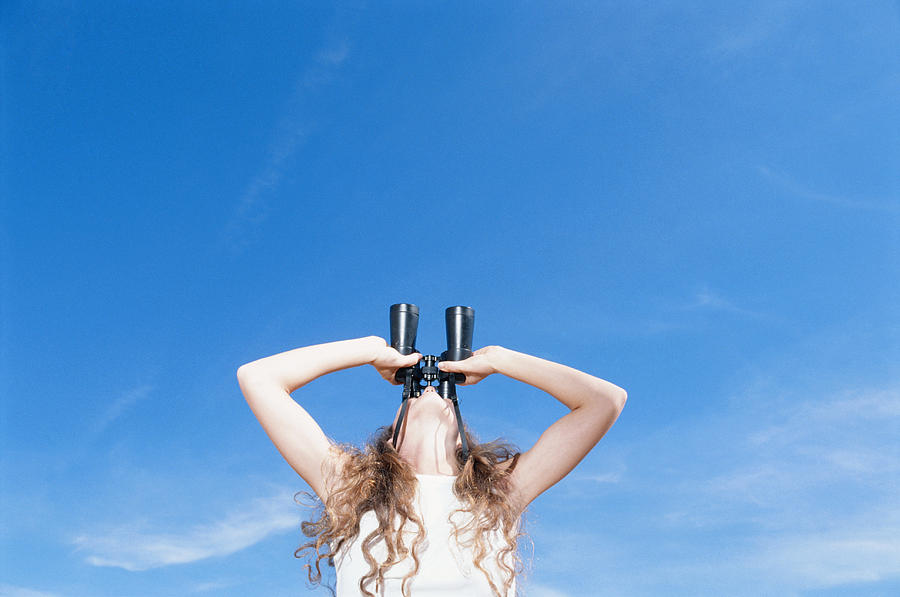 Woman Using Binocular, Looking Up, Low Angle View Photograph by David De Lossy