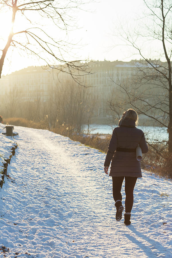 Woman Walking Along Path With Photograph by Ascent/pks Media Inc.