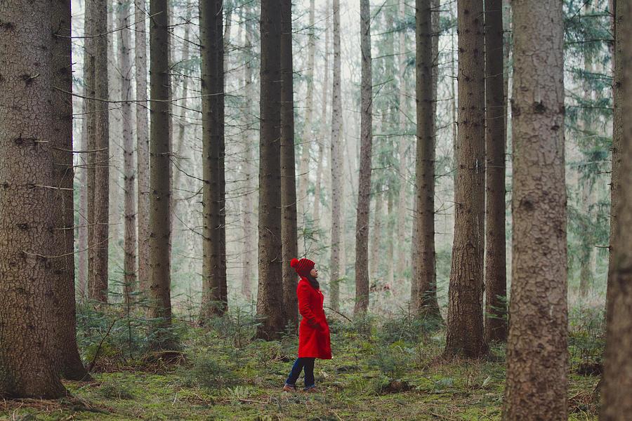Woman Walking Along Wooded Road Photograph by Julia Davila-Lampe