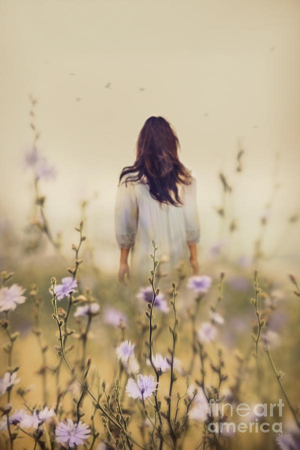 Alone Photograph - Woman Walking In Field Of Blue Flowers by Sandra Cunningham