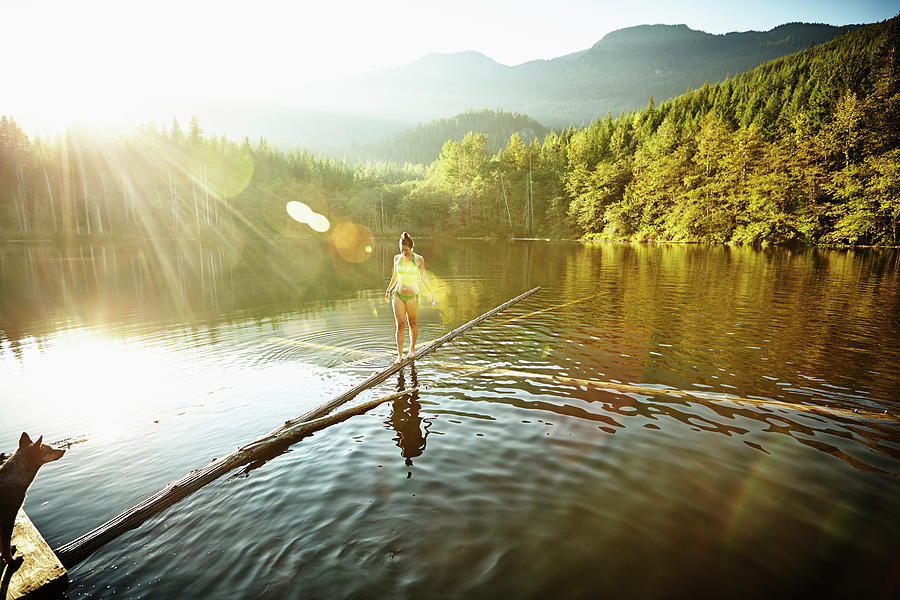 Woman Walking On Log In Alpine  Lake Photograph by Thomas Barwick