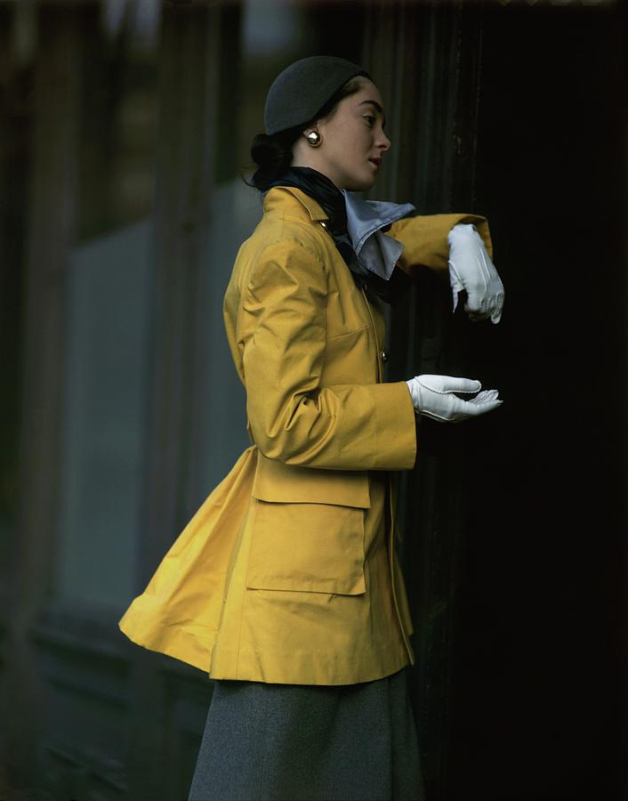 Woman Wearing A Yellow Coat Photograph by Frances McLaughlin-Gill