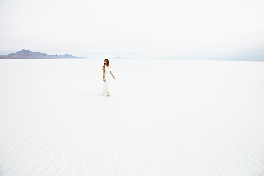Woman Wearing Dress Walking Through Photograph by Thomas Barwick