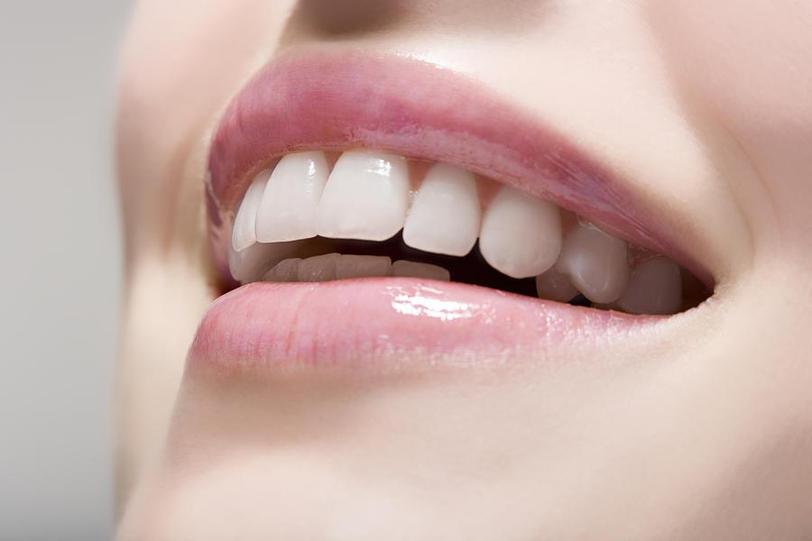 Woman Wearing Lip Gloss Photograph by Image Source