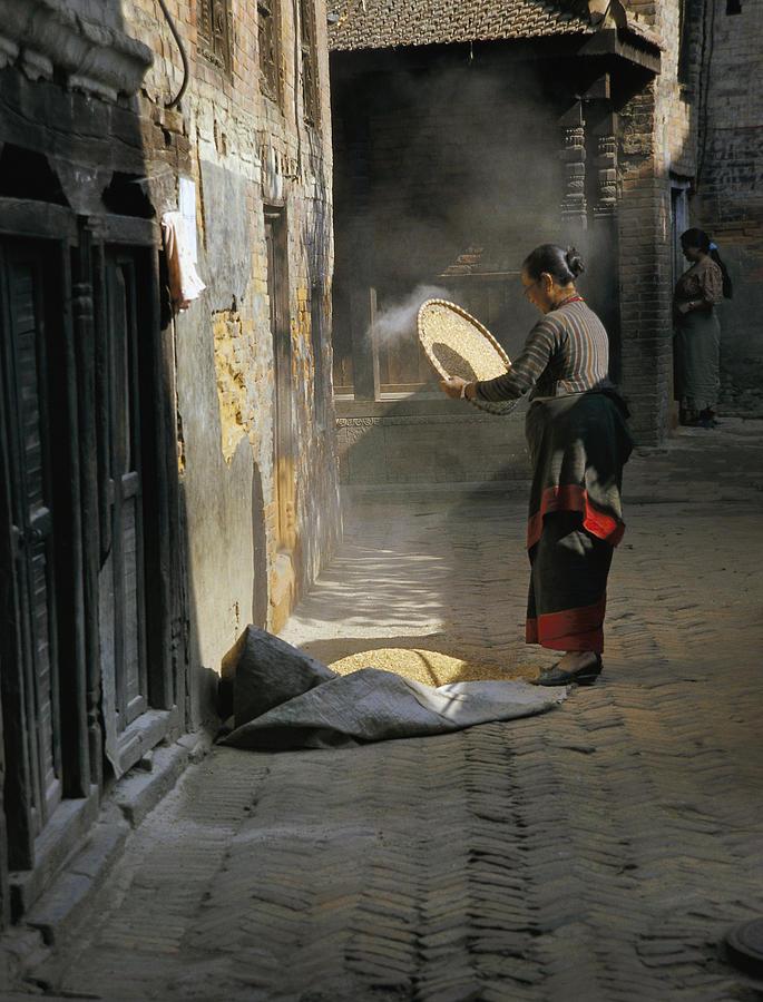 Travel Photograph - Woman Winnowing by Richard Berry