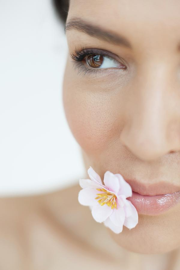 Female Photograph - Woman With Flower by Ian Hooton/science Photo Library