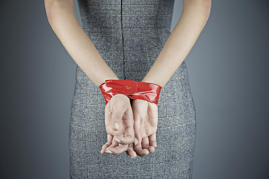 Woman with hands tied behind back Photograph by Compassionate Eye Foundation