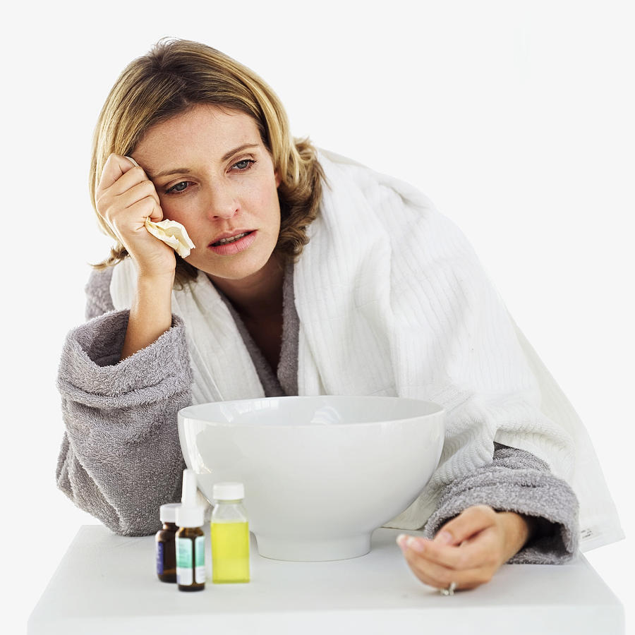 Woman With The Flu Photograph by Stockbyte