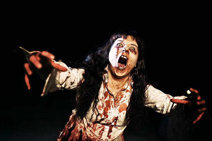 Woman zombie walks at night Photograph by Laura Natividad