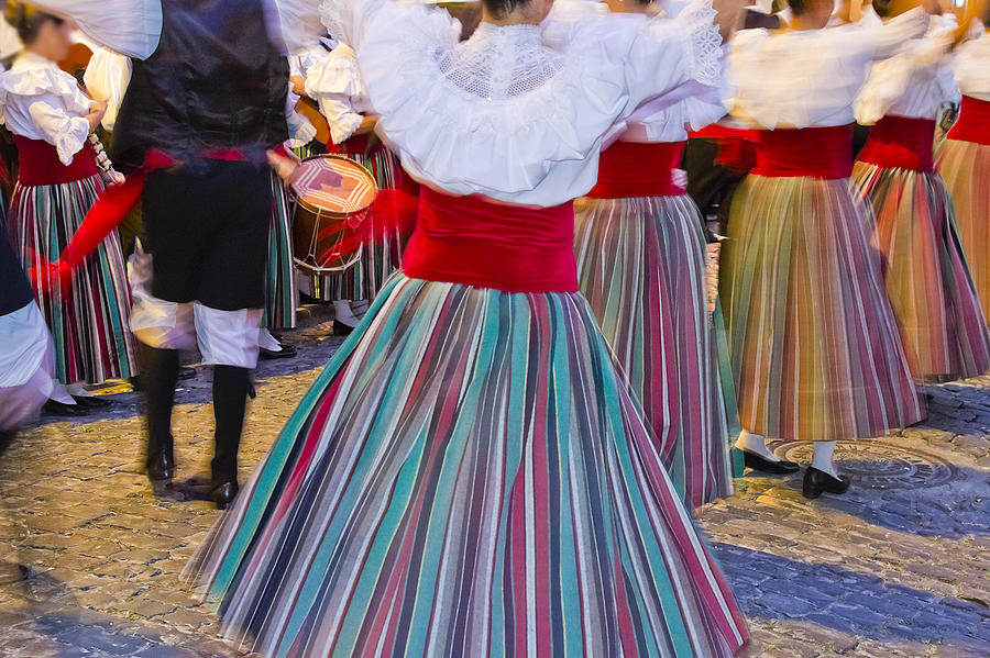 Women dancing in traditional clothing for a celebration Photograph by Oriredmouse