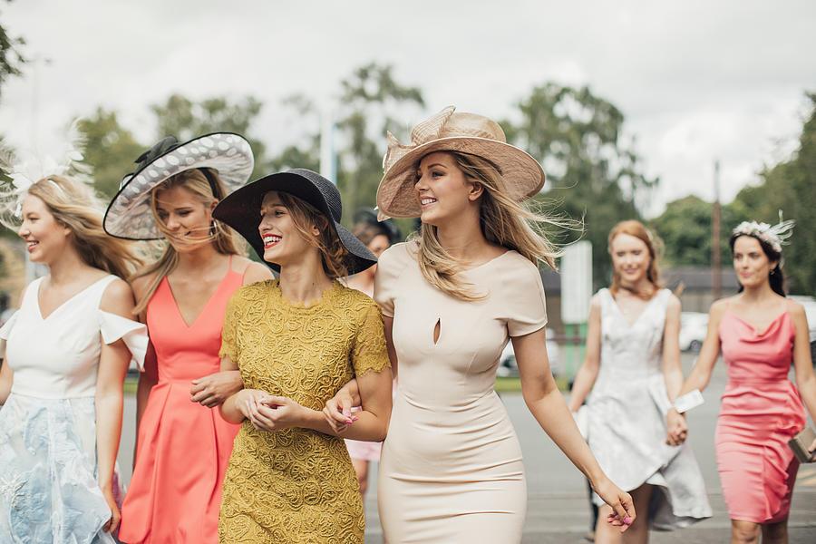 Women Walking to Racecourse Photograph by SolStock