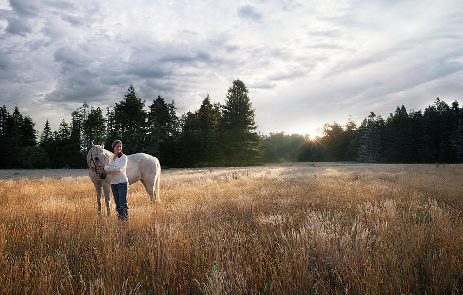 Women With White Horse In Forest Meadow Photograph by Justin Lewis