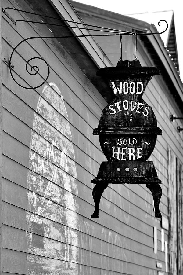 Sign Photograph - Wood Stoves Sold Here by Christine Till