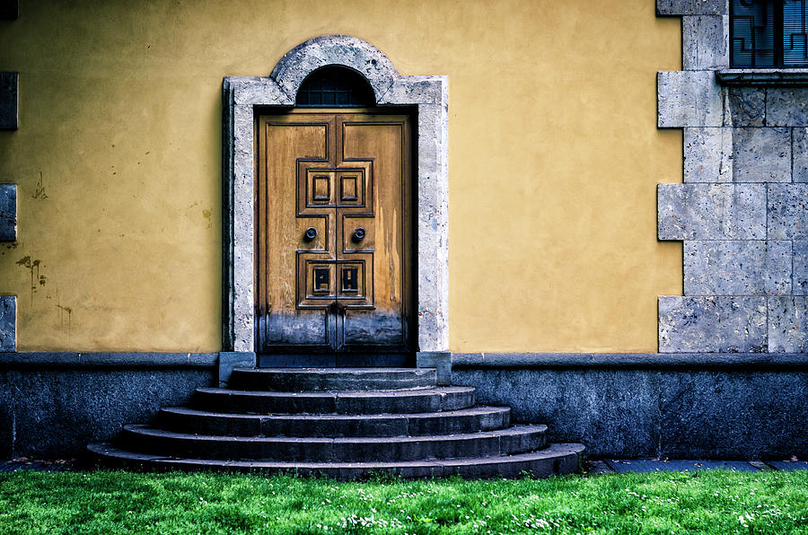 Wooden Door With Marble Frame And Stone Photograph by Ardenvis