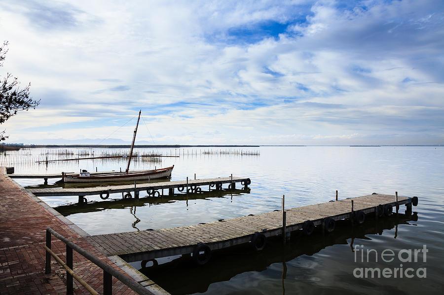 Wooden Jetties on the stillness of Lake Albufera Spain by Peter Noyce