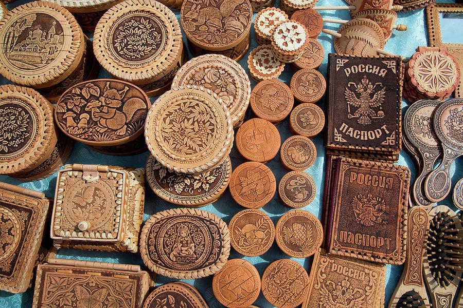 Wooden Souvenirs For Sale At Market Photograph by Holger Leue