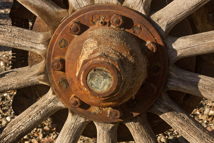 Wheel Photograph - Wooden Wagon Wheel by Art Block Collections